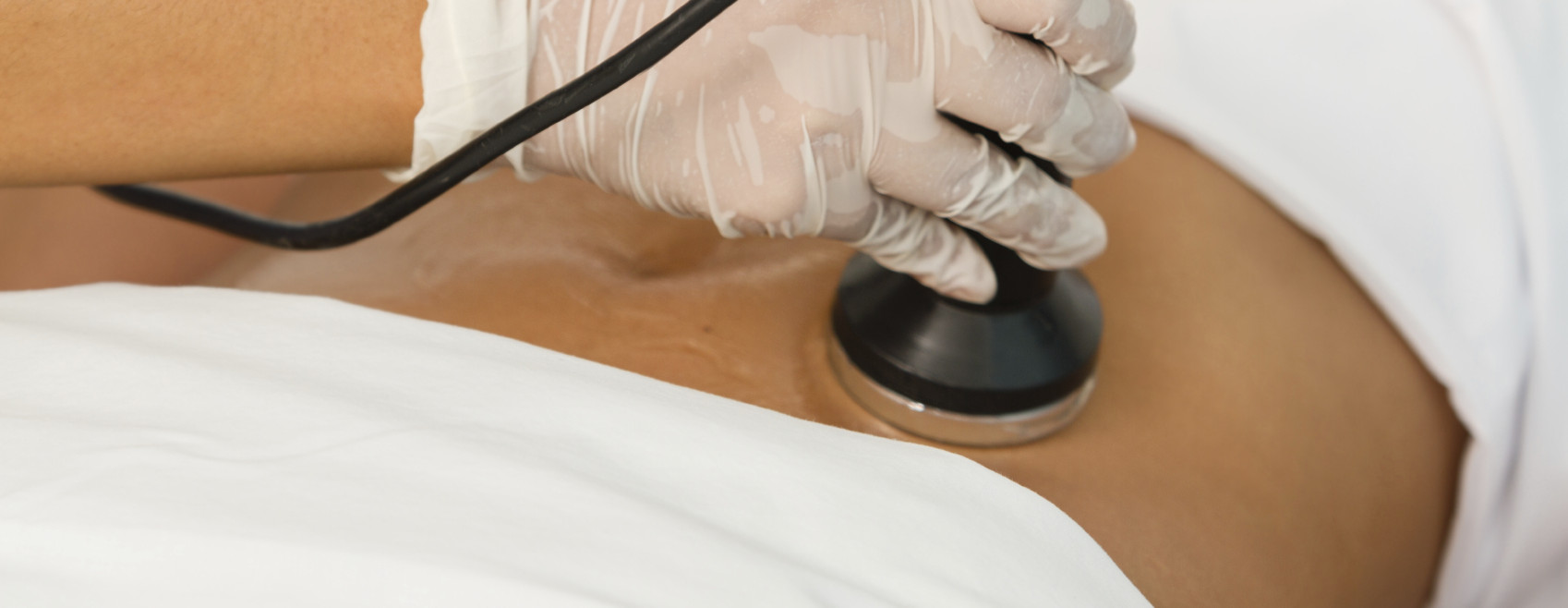 Close up of a woman getting a cavitation treatment